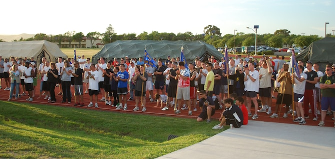 Viking Challenge participants await the awards presentation during the event's closing ceremonies May 9.  More than 300 people participated in the 12-hour relay, which is the Travis Fisher House's largest fundraiser each year. (U.S. Air Force photo/1st Lt. Nicole Langley)
