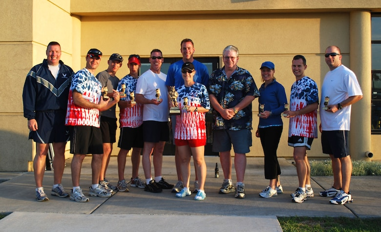 After receiving the award for the Most Money Raised by a Team, the 615th Contingency Response Wing Phoenix Mobility Team, who also organized the event, pose for a photo with Col. John Lipinski, 615th CRW commander (left) and Rick Writer, Eagle Eye Engraving, who sponsored all of the trophies, t-shirts and water bottles for participants.  Viking Challenge, an annual 12-hour relay event, is the Travis Fisher House's largest fundraiser each year.  (U.S. Air Force photo/1st Lt. Nicole Langley)