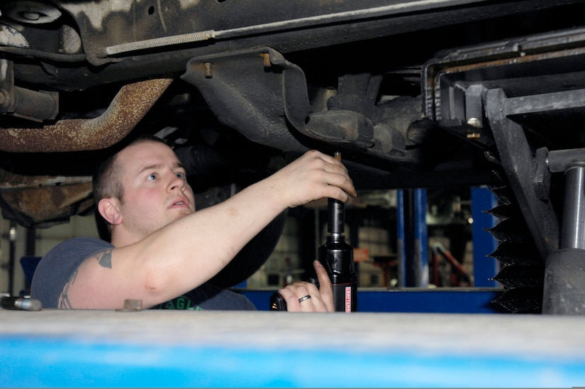 """ELMENDORF AIR FORCE BASE, Alaska -- Robert Miller works on removing his flex plate from his truck, May 8 at the auto shop during """"do it yourself"""" hours. Miller is from the 381st Intelligence Squadron.(U.S. Air Force photo/Airman 1st Class Christopher Gross)"""