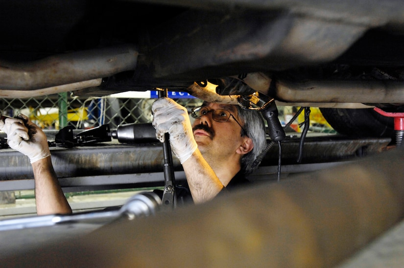 ELMENDORF AIR FORCE BASE, Alaska -- Wes Rasmassen from the Elmendorf Auto Hobby Shop carefully removes the transmission from this 1971 Chevey Corvette May 7. Rasmassen has been with the shop for the past 10 and a half years.(U.S. Air Force photo/Airman 1st Class Christopher Gross)