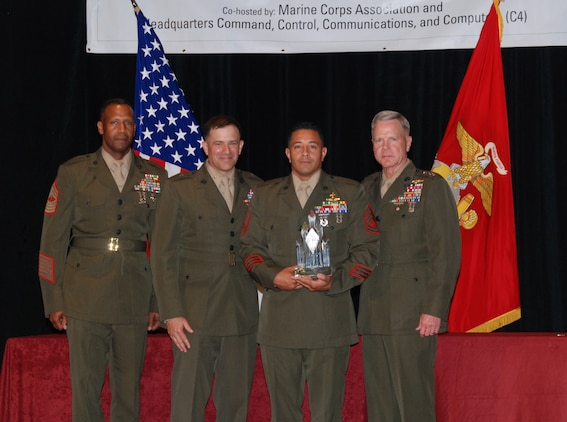 ARLINGTON, V.A. – Gunnery Sgt. Eric C. Hernandez (Second from right), Communications Chief for a company with 2d Marine Special Operations Battalion, is presented with the 2008 PFC Herbert A. Littleton Enlisted Communications Award trophy while standing shoulder to shoulder with (from left to right) MGySgt Byron M. Bissessar, U.S. Marine Corps Communications Chief, Brig. Gen. George J. Allen, C4 Director and Gen. James F. Amos, Assistant Commandant of the Marine Corps, here May 13.
