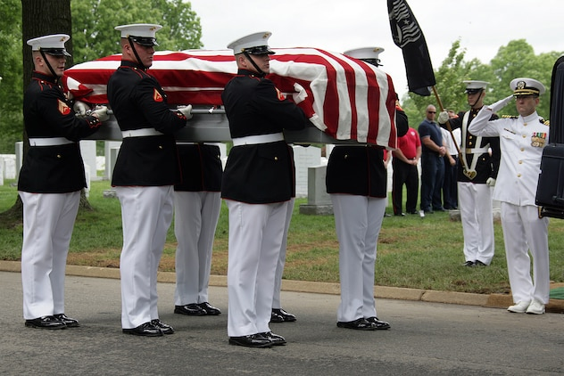 Casket bearers remove a casket from its escort vehicle during a group repatriation service May 14. A throng of family members and Marine veterans gathered to remember the service and sacrifice of six Vietnam War casualties whose remains had recently been identified and repatriated.