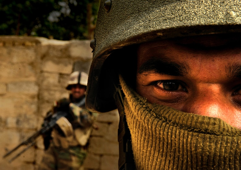 The Stacy Pearsall Combat Photo Gallery — A Military Photographer of the Year, Pearsall's work has been viewed worldwide. A soldier from the Iraqi army provides security during a foot patrol in Baqubah, Iraq, on Mar. 30, 2007. (photo by Staff Sgt. Stacy Pearsall)