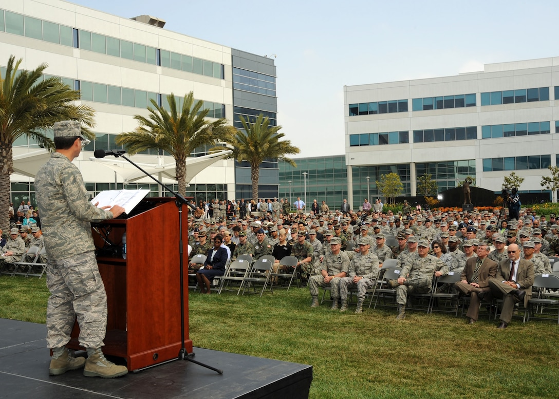 SMC Commander Lt. Gen. Tom Sheridan addressed base personnel during an all call, May 13. The general spoke about some of the milestones and program changes during his first year as commander here. After speaking, he and CMSgt. Stephen Ludwig fielded questions from the crowd. (Photo by Lou Hernandez)