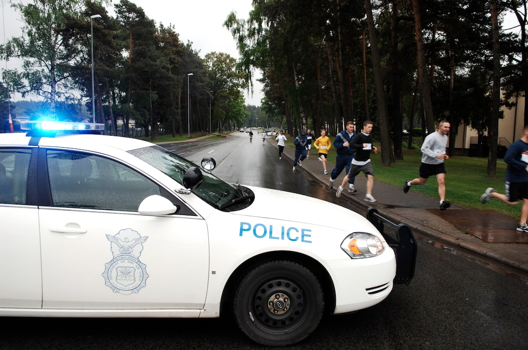 Members from police units in the Kaiserslautern Military Community participate in a relay race starting on Vogelweh Military Complex, Germany, May 12, 2009. The race is one of many events taking place in celebration of National Police Week, a solemn period each year where every officer reflects on those who have fallen. (U.S. Air Force photo by Senior Airman Amber Bressler)