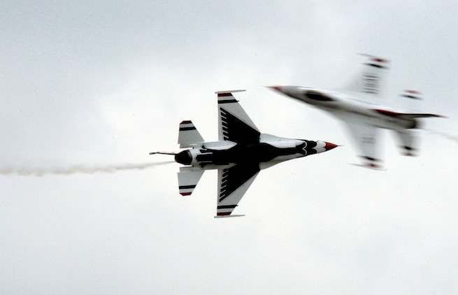 The Air Force Thunderbirds demonstrate one of their maneuvers during the 2009 Joint Service Open House May 15. Local Virginia and Maryland residents couldn't avoid the aerial aerobatics or interactive displays, as an estimated 100,000 people attended the JSOH.