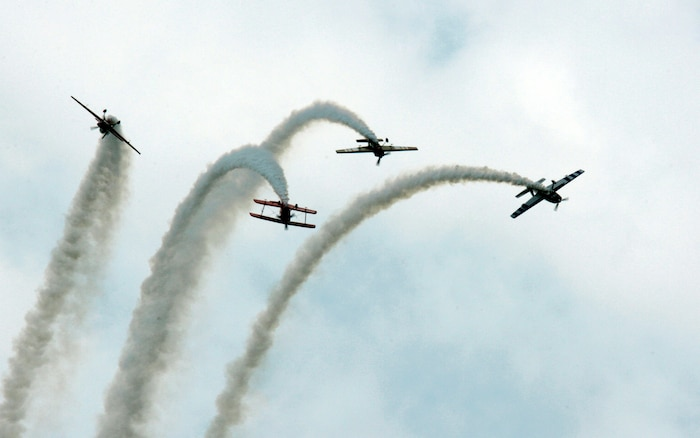 Sean Tucker and The Collaborators perform their dynamic signature aerobatics during the 2009 Joint Service Open House May 15. Area patrons and military families were intrigued by military aircraft from World War I to currently fielded technologies, while aviators and stunt pilots from the Army, Air force and Navy performed maneuvers and demonstrated evasive actions taken in combat.