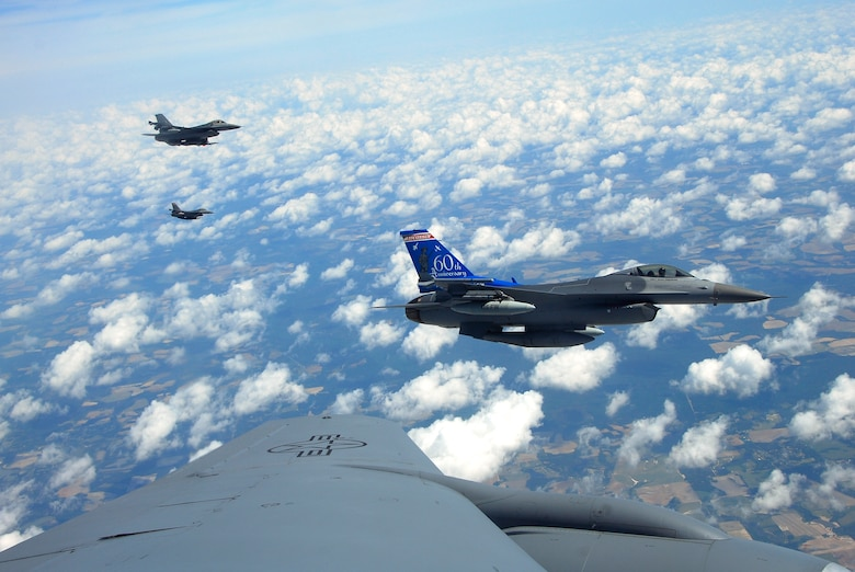 F-16C Fighting Falcons from the 115th Fighter Wing, Madison, Wis. fly along side a KC-135R Stratotanker from the 128th Air Refueling Wing, Milwaukee, Wis. as they prepare to be refueled in flight.  The 115th FW participated in an air-to-air combat skills training exercise April 18 - May 2, 2009 along side their naval counterparts from Strike Fighter Squadron 2 (VFA-2), Naval Air Station Lemoore, Calif., while stationed at Naval Air Station Key West, Fla.  The training missions featured air-to-air and air-to-ground offensive and defensive combat tactics designed to simulate real-world operations.  (U.S. Air Force photo by Master Sgt. Dan Richardson)
