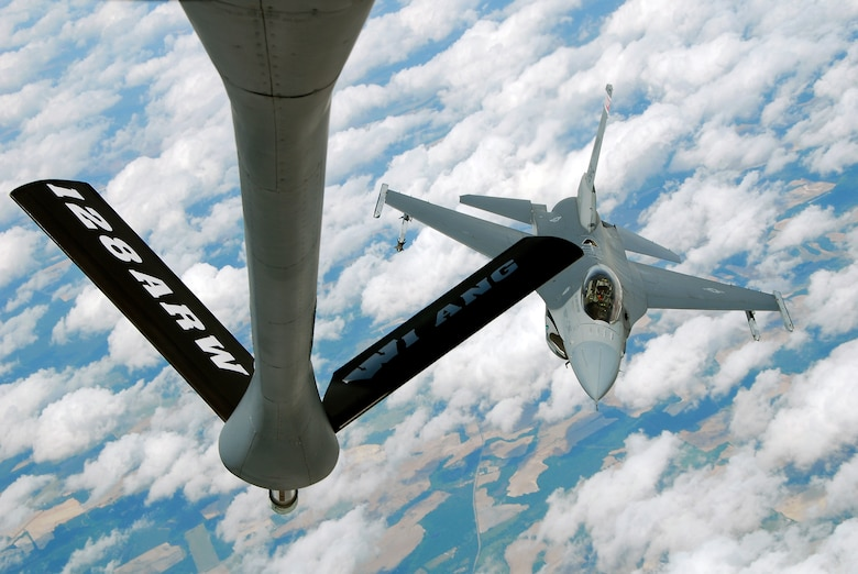 An F-16C Fighting Falcon from the 115th Fighter Wing, Madison, Wis. prepares to be refueled by a KC-135R Stratotanker from the 128th Air Refueling Wing, Milwaukee, Wis. The 115th FW participated in an air-to-air combat skills training exercise April 18 - May 2, 2009 along side their naval counterparts from Strike Fighter Squadron 2 (VFA-2), Naval Air Station Lemoore, Calif., while stationed at Naval Air Station Key West, Fla.  The training missions featured air-to-air and air-to-ground offensive and defensive combat tactics designed to simulate real-world operations.  (U.S. Air Force photo by Master Sgt. Dan Richardson)