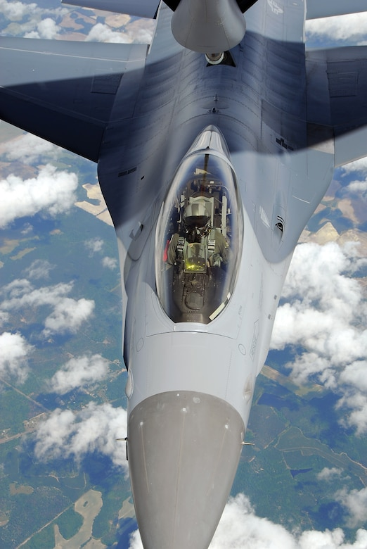 An F-16C Fighting Falcon from the 115th Fighter Wing, Madison, Wis. is refueled by a KC-135R Stratotanker from the 128th Air Refueling Wing, Milwaukee, Wis. The 115th FW participated in an air-to-air combat skills training exercise April 18 - May 2, 2009 along side their naval counterparts from Strike Fighter Squadron 2 (VFA-2), Naval Air Station Lemoore, Calif., while stationed at Naval Air Station Key West, Fla.  The training missions featured air-to-air and air-to-ground offensive and defensive combat tactics designed to simulate real-world operations.  (U.S. Air Force photo by Master Sgt. Dan Richardson)