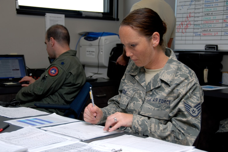 Technical Sgt. Virginia Krauss, a knowledge operations craftsman, with the 115th Fighter Wing, Madison, Wis., works to file flight plans for the units F-16 pilots.  The 115th Fighter Wing participated in an air-to-air combat skills training exercise April 18 - May 2, 2009 along side their naval counterparts from Strike Fighter Squadron 2 (VFA-2), Naval Air Station Lemoore, Calif., while deployed to Naval Air Station Key West, Fla.  The training missions featured air-to-air and air-to-ground offensive and defensive combat tactics designed to simulate real-world operations.  (U.S. Air Force photo by: Master Sgt. Dan Richardson)