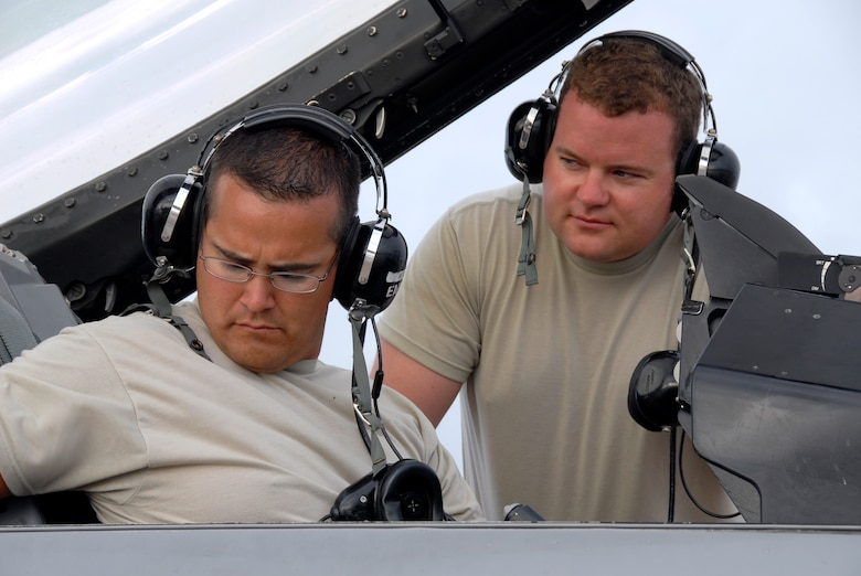 Technical Sgt. Brian Stapley (left) and Technical Sgt. Matt Randall (right), avionics technicians with the 115th Fighter Wing, Madison, Wis., perform an operational check of avionics equipment on one of the units F-16C aircraft April 30, 2009. The 115th FW participated in an air-to-air combat skills training exercise April 18 - May 2, 2009 along side their naval counterparts from Strike Fighter Squadron 2 (VFA-2), Naval Air Station Lemoore, Calif., while deployed to Naval Air Station Key West, Fla.  The training missions featured air-to-air and air-to-ground offensive and defensive combat tactics designed to simulate real-world operations.  (U.S. Air Force photo by: Master Sgt. Dan Richardson)