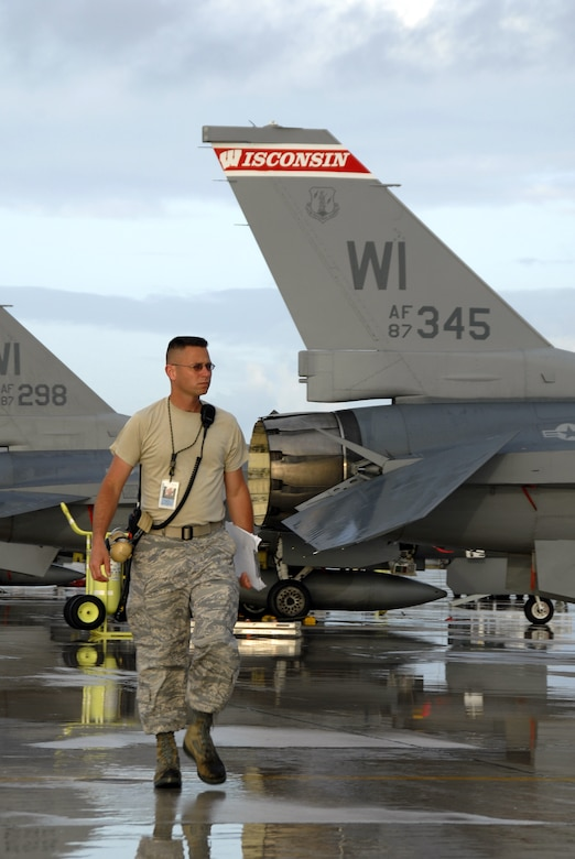 Senior Master Sgt. Scott Edmonston, a tactical aircraft superintendant with the 115th Fighter Wing, Madison, Wis., supervises the preparation of the units F-16C Fighting Falcons prior to a morning launch.  The 115th FW participated in an air-to-air combat skills training exercise April 18 - May 2, 2009 along side their naval counterparts from Strike Fighter Squadron 2 (VFA-2), Naval Air Station Lemoore, Calif., while deployed to Naval Air Station Key West, Fla.  The training missions featured air-to-air and air-to-ground offensive and defensive combat tactics designed to simulate real-world operations.  (U.S. Air Force photo by: Master Sgt. Dan Richardson)