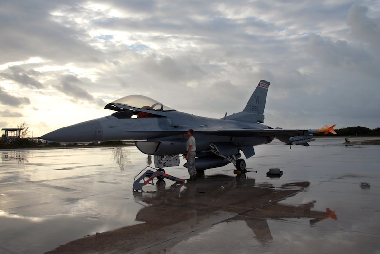 Staff Sgt. Brian Gilbertson, a crew chief with the 115th Fighter Wing, Madison, Wis.,  prepares one of the units F-16C Fighting Falcons for flight after a rain storm April 30, 2009.  The 115th FW participated in an air-to-air combat skills training exercise April 18 - May 2, 2009 along side their naval counterparts from Strike Fighter Squadron 2 (VFA-2), Naval Air Station Lemoore, Calif., while deployed to Naval Air Station Key West, Fla.  The training missions featured air-to-air and air-to-ground offensive and defensive combat tactics designed to simulate real-world operations.  (U.S. Air Force photo by: Master Sgt. Dan Richardson)