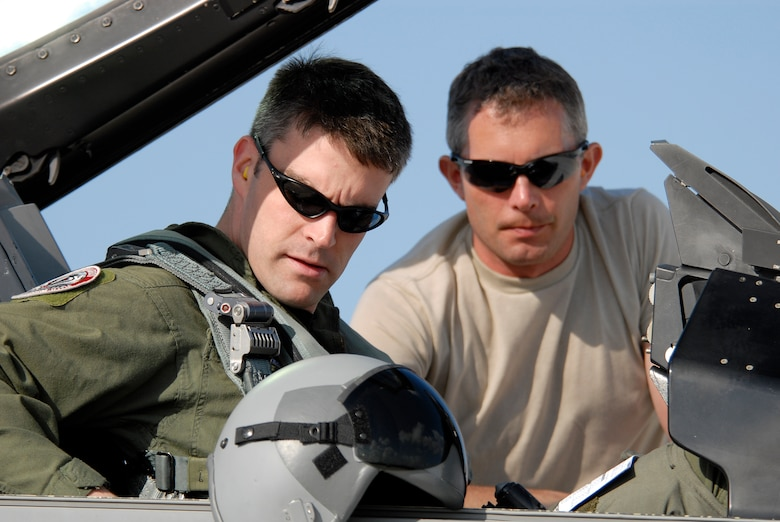 Capt.Tony Hart, an F-16 fighter pilot is assisted by Technical Sgt. Mike Hall, a crew chief, strapping into the cockpit of an F-16C Fighting Falcon.  Both are members of 115th Fighter Wing, Madison, Wis. 115th FW participated in an air-to-air combat skills training exercise April 18 - May 2, 2009 along side their naval counterparts from Strike Fighter Squadron 2 (VFA-2), Naval Air Station Lemoore, Calif., while deployed to Naval Air Station Key West, Fla.  The training missions featured air-to-air and air-to-ground offensive and defensive combat tactics designed to simulate real-world operations.  (U.S. Air Force Photo by Master Sgt. Dan Richardson)