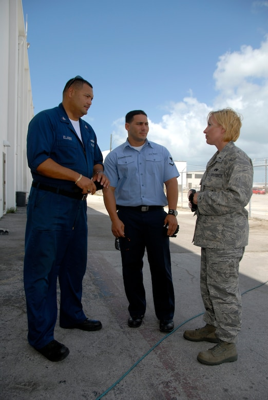 Petty Officers 3rd Class Ernesto Eljaiek and Reynel Echemenia, NAS Key West hazardous materials specialists and fleet liaisons, work with 1st Lt. Christy Kasten, 115th Fighter Wing maintenance officer, on hangar logistics as the wing prepared to complete its deployment April 29, 2009.  The 115th FW participated in an air-to-air combat skills training exercise April 18 - May 2, 2009 along side their naval counterparts from Strike Fighter Squadron 2 (VFA-2), Naval Air Station Lemoore, Calif., while deployed to Naval Air Station Key West, Fla.  The training missions featured air-to-air and air-to-ground offensive and defensive combat tactics designed to simulate real-world operations.  (U.S. Air Force photo by Master Sgt. Dan Richardson)