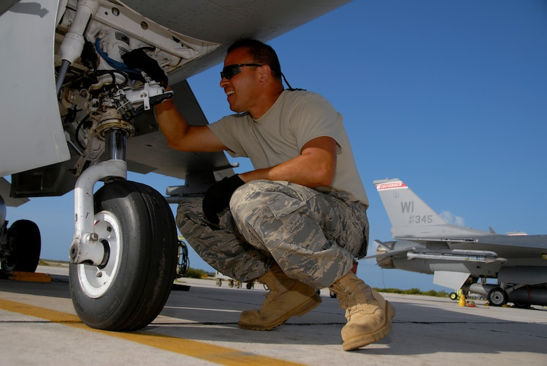 Staff Sgt. Jose Irizarry, a crew chief with the 115th Fighter Wing, Madison, Wis., inspects the nose gear on one of the units F-16C Fighting Falcons prior to the days missions April 29, 2009. The 115th FW participated in an air-to-air combat skills training exercise April 18 - May 2, 2009 along side their naval counterparts from Strike Fighter Squadron 2 (VFA-2), Naval Air Station Lemoore, Calif., while deployed to Naval Air Station Key West, Fla.  The training missions featured air-to-air and air-to-ground offensive and defensive combat tactics designed to simulate real-world operations.  (U.S. Air Force photo by Master Sgt. Dan Richardson)