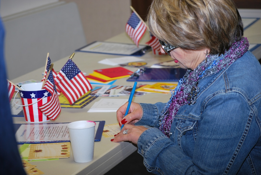 Their Angels volunteer Iren Jenny writes a letter of gratitude to deployed troops at the Military Appreciation Month ceremony held at Hilltop Church of Christ in Richmond, Calif., May 2, 2009. The letters were shipped in care packages to deployed troops.
