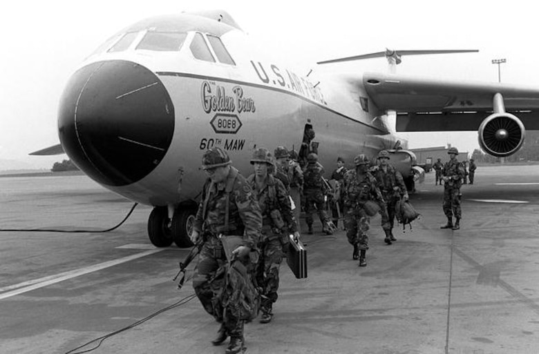 Troops disembark the Golden Bear in this undated photo. Though the last operational C-141 would depart Travis on Dec. 16, 1997, the Golden Bear would stay on at the base as a testament of everlasting endurance. On Sept. 16, 2005, the Golden Bear was dedicated as an aircraft display by the men and women of Travis. (U.S. Air Force photo)