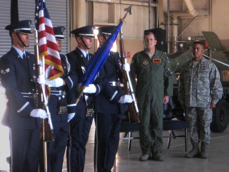 The Nellis Honor Guard posts the colors during the activation ceremony for the U.S. Air Force Reserve's 926th Aircraft Maintenance Squadron on May 15. Through Total Force Integration, the squadron's personnel work on F-15, F-16 and F-22 aircraft within Regular Air Force units.