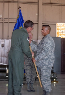 Maj. Michael Egbalic (right), accepts the 926th Aircraft Maintenance Squadron guideon from Col. David Culbertson, 926th Group commander, as he takes command of the newly-activated U.S. Air Force Reserve squadron May 15. Through the Air Force's Total Force Integration initiative, the squadron's members work on F-15, F-16 and F-22 aircraft within Regular Air Force units.