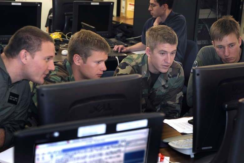 Cadets successfully defend a computer network against simulated intrusions during a Cyber-Defense Exercise April 24. The cyber exercise is a computer security competition designed to educate cadets about the role of information assurance in protecting critical information systems. (U.S. Air Force photo)