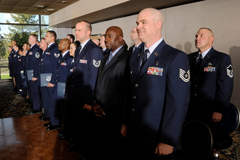 Community College of the Air Force graduates receive their degrees during a ceremony at the U.S. Air Force Academy's Falcon Club May 7. Many of the 84 graduates worked on obtaining their CCAF degrees during or between deployments. (U.S. Air Force photo/Mike Kaplan)