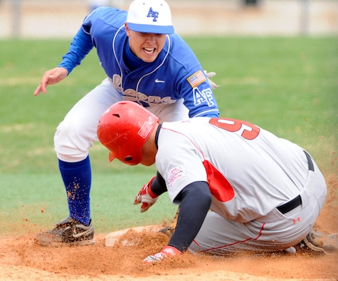Air Force Falcons shortstop Adam Hill makes the tag on a Utah Utes player's attempt to steal a base. Air Force dropped a doubleheader to the Utes May 3, 12-6 and 19-8. (U.S. Air Force photo/J. Rachel Spencer)