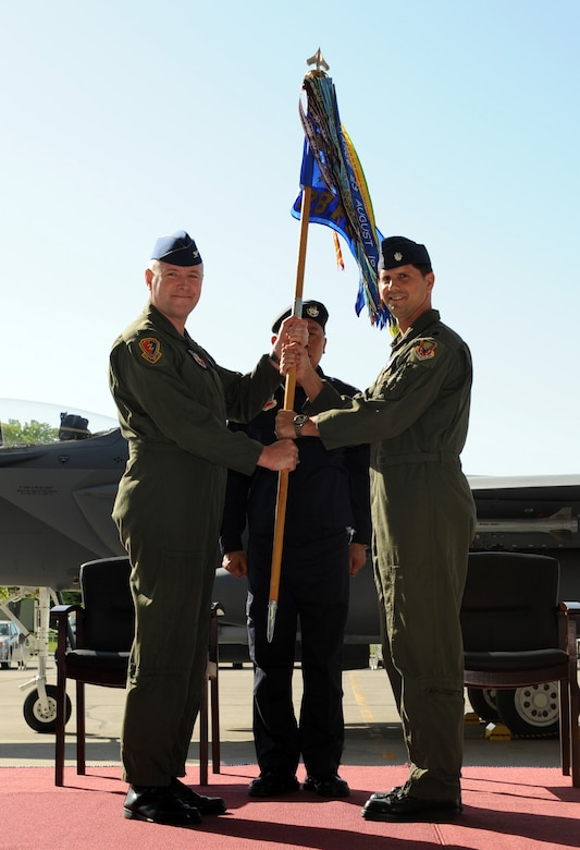 MOUNTAIN HOME AIR FORCE BASE, Idaho – Republic of Singapore air force Staff Sgt. Ricky Morier, 428th Fighter Squadron flightline crew, unveils Lt. Col. Keith Gibson and Maj. Robin Tan's names on the side of an F-15SG during the reactivation and assumption-of-command ceremony May 18. The U.S. Air Force reactivated the 428th FS here as part of the Peace Carvin V program-- an international partnership between the United States and Republic of Singapore. The combined U.S. Air Force and Republic of Singapore air force unit will train RSAF aircrews in F-15SG fighters. (U.S. Air Force photo by Airman 1st Class Debbie Lockhart)