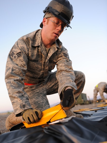 WENDOVER, Utah -- Senior Airman Michael Strouce, 726th Air Control Squadron aerospace ground equipment journeyman, prepares a hazardous spill container for fuel trucks while setting up the training site at Wendover, Utah, during a week-long training exercise May 8 to 15. The 726th ACS tackles a wide-spread mission including enemy surveillance and identification, weapons control, joint and combined data-link connectivity, and battle management of offensive and defensive air activities. The squadron is made up of 27 different Air Force career fields, making it self-sustaining and able to deploy and fully operate without external support or help. (U.S. Air Force photo\Airman 1st Class Debbie Lockhart)