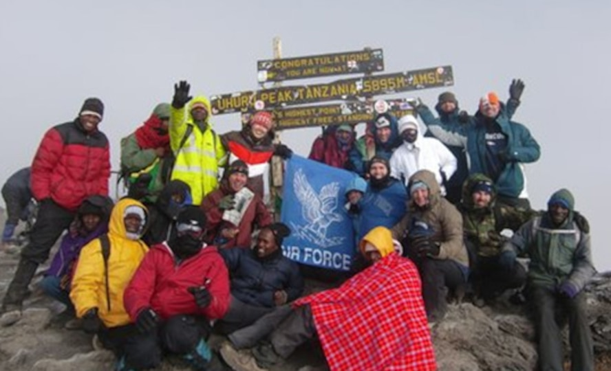 MOUNT KILIMANJARO, Tanzania -- USAF 7 Summit members pictured with their guides atop Mount Kilimanjaro after their four day climb to the top of Africa's highest point. (Courtesy photo)