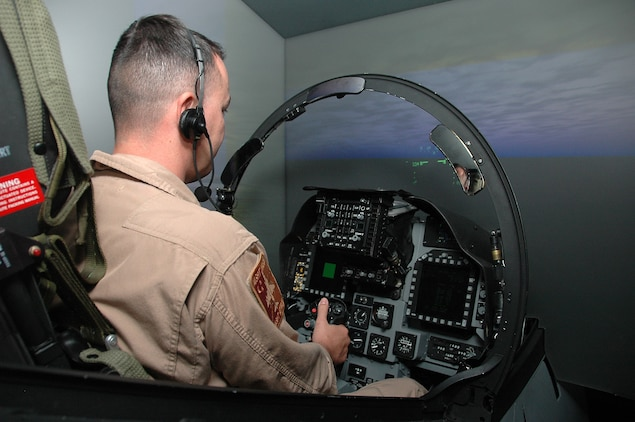 Maj. Grant Pennington, Marine Corps Air Station Yuma, Ariz., Marine Aviation Training Systems Site officer in charge, performs tests run of the new AV-8B Harrier simulator May 19, 2009. The simulator, which can run both day and night missions, is scheduled to be available to pilots Aug. 31, 2009. MATSS plans to receive two F-35 Joint Strike Fighter simulators and possibly one unmanned aerial vehicles simulator within a year or two, and have them linked on a local network with its two Harrier simulators. MATSS also plans for the simulators to eventually be linked to a joint, nationwide network by 2012, allowing pilots here to fly simulated scenarios with other services and their respective aircraft.(Photo by Lance Cpl. Austin Hazard)