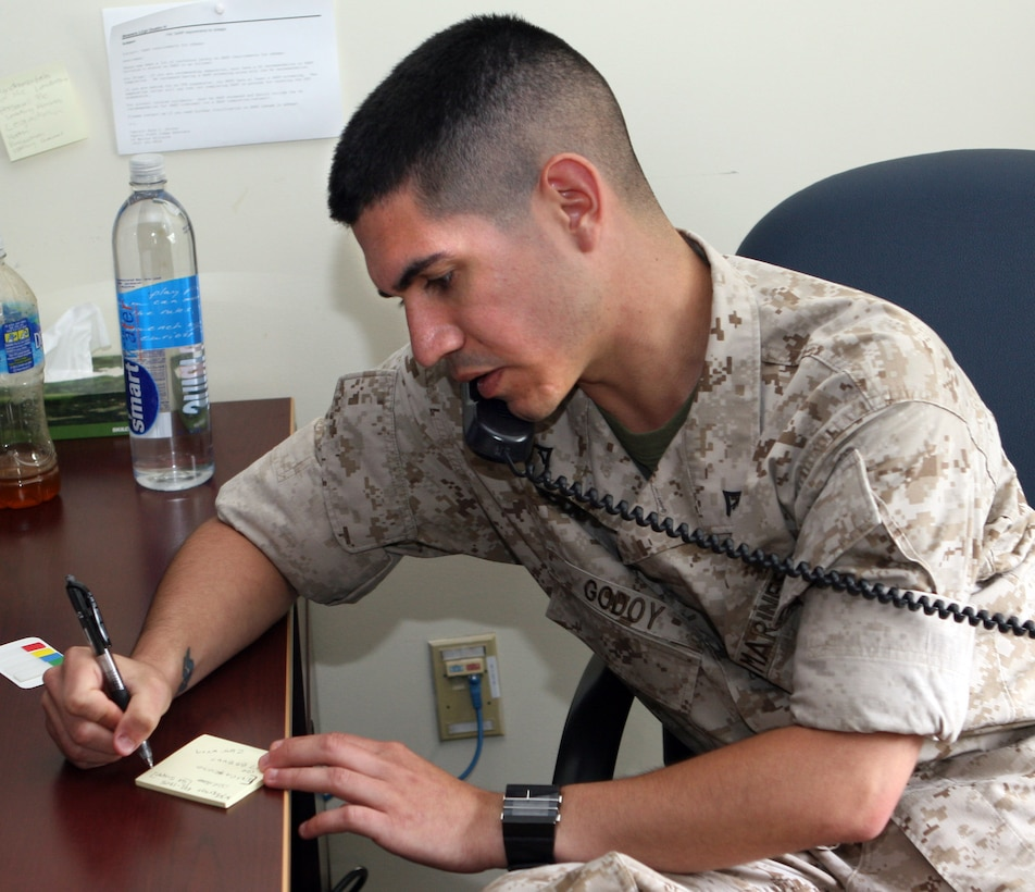 Legal services specialist Lance Cpl. Albert Godoy takes a phone message at the Legal Services Support Section, 2nd Marine Logistics Group, here, May 20. Marine Corps Base Camp Lejeune's LSSS has the biggest docket in the entire Department of Defense. (Official U.S. Marine Corps photo by Lance Cpl. John A. Faria) (RELEASED)