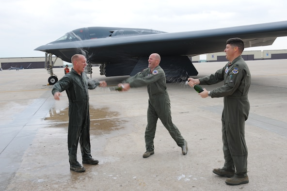 WHITEMAN AIR FORCE BASE, Mo. - Col. John Robinson (right), 509th Bomb Wing vice commander, and Maj. Bob Bryant(center), 509th Bomb Wing executive officer, spray Chief Master Sgt. Brian Hornback, 509th Bomb Wing command chief, with champagne after his first and last flight in a B-2 bomber May 15. (U.S. Air Force photo/Tech. Sgt. Charles Larkin)