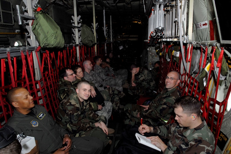 """Airmen of the 133rd Airlift Wing, St. Paul, Minn. fly in one of the unit's C-130 """"Hercules"""" aircraft to a training mission at Volk Field, Wis. on May 13, 2009. Hundreds of men and women from the Minnesota Air National Guard unit joined otheres from Scott Air Force Base, Illinois for Readiness Safeguard in preparation for an Operational Readiness Inspection. USAF Official photo by Technical Sgt. Erik Gudmundson."""