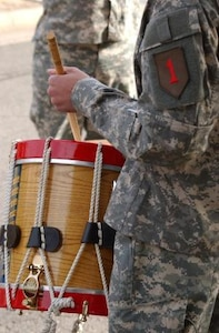 A member of the 1st Infantry Division Band plays the drum.  The Band is available for performances throughout Kansas.