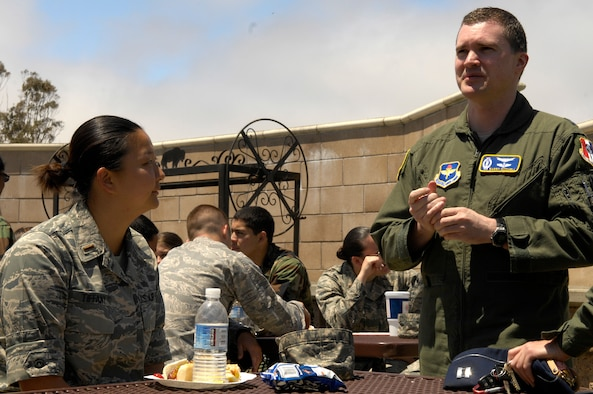 VANDENBERG AIR FORCE BASE, Calif. -- Learing from a professional, 2nd Lt. Jessie Tiffany, a Space 100 student with the 392nd Training Squadron, receives career advice from 381st Training Group instructor Capt. Barry Mitchell about her new assignment to Malmstrom AFB, Mont., during a squadron burger burn here May 19. The cookout is traditionally held for students after they receive their new assignments.(U.S. Air Force photo/Senior Airman Matthew Plew)