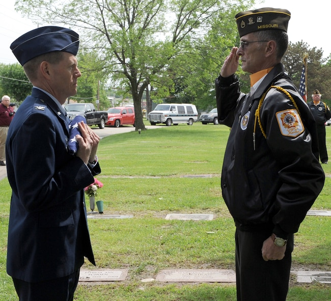 WHITEMAN AIR FORCE BASE, Mo. - Mr.  Joe Cochran, Veterans of Foreign Wars Post 2591 Honors Team, renders a salute to  Col. Robert Wheeler, 509th Bomb Wing commander after presentation of the flag flown at the 21st Memorial Wreath Laying Ceremony honoring 2nd Lt. George A Whiteman's sacrifice during the attack on Pearl Harbor.  (U.S. Air Force photo/Airman 1st Class Carlin Leslie)