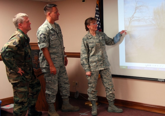 Air Force Emergency Preparedness Liaison Officer Col. Stacy Collins, right, discusses the North Dakota flood with Col. Jon Spangler, left, and Senior Master Sgt. Brian Bischoff, all of whom attended a recent EPLO orientation at Tyndall AFB. U.S. Air Force Photo by Lisa Norman
