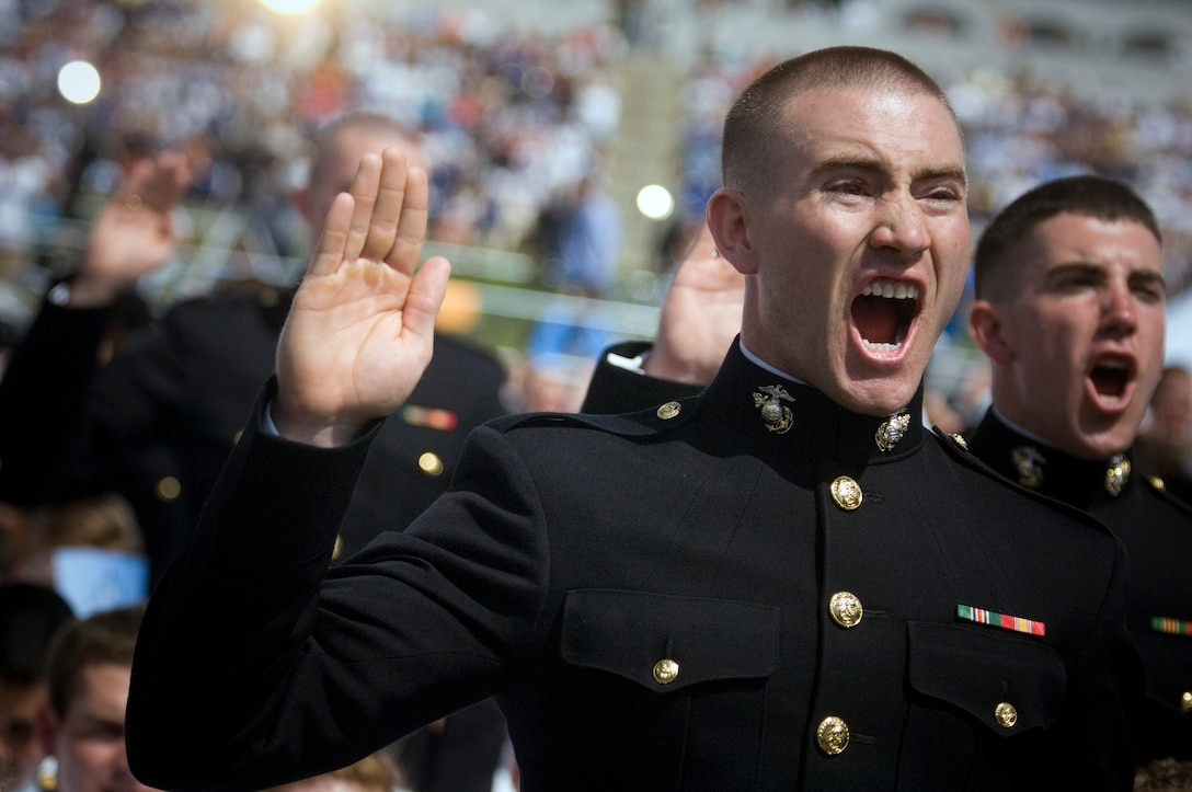2nd Lt. Matthew Forman recites the oath of office alongside other Marines and Navy ensigns during their graduation and commissioning ceremony at the Navy-Marine Corps Memorial Stadium at the U.S. Naval Academy in Annapolis, Md., May 22. President Barack Obama delivered the commencement address during the class.