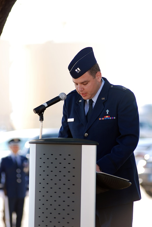 Chaplain Jesse Howard offers the invocation as the 433rd Airlift Wing stopped for a Memorial Day ceremony at the Bravo-12 Memorial Grove the Thursday before Memorial Day 2009. Bravo-12 was the call sign for a C-5 that crashed in 1990. The grove, built in memory of the crew, now serves as a memorial to all of the fallen Airmen from the Alamo Wing. (U.S. Air Force Photo/Airman Brian McGloin)