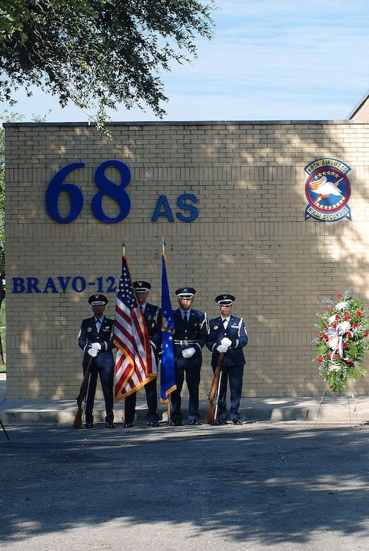 The 433rd Airlift Wing stopped for a Memorial Day ceremony at the Bravo-12 Memorial Grove the Thursday before Memorial Day 2009. Bravo-12 was the call sign for a C-5 that crashed in 1990. The grove, built in memory of the crew, now serves as a memorial to all of the fallen Airmen from the Alamo Wing. (U.S. Air Force Photo/Airman Brian McGloin)