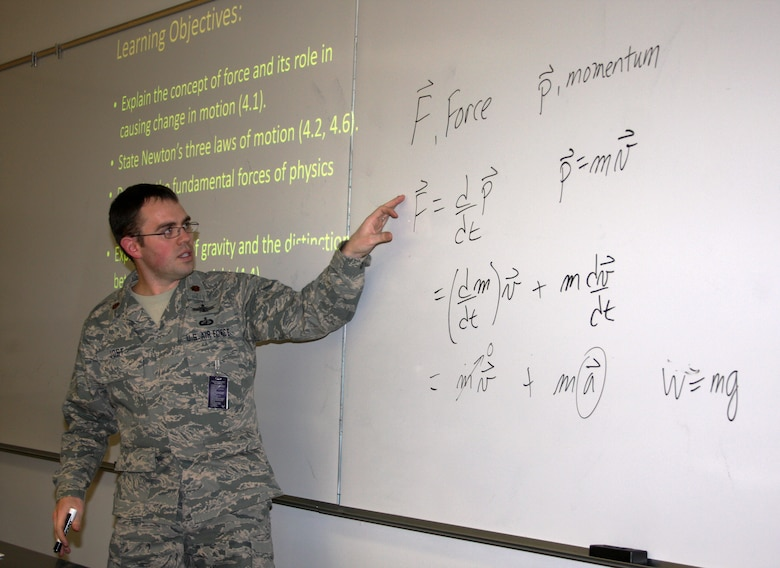 Maj. Thomas Jost leads cadets through a core physics class at the U.S. Air Force Academy in Colorado Springs, Colo., Jan. 16. As cadets learn about Newton's laws of gravitation, they also learn valuable lessons about determination and perseverance. (U.S. Air Force photo/Arnie Spencer)