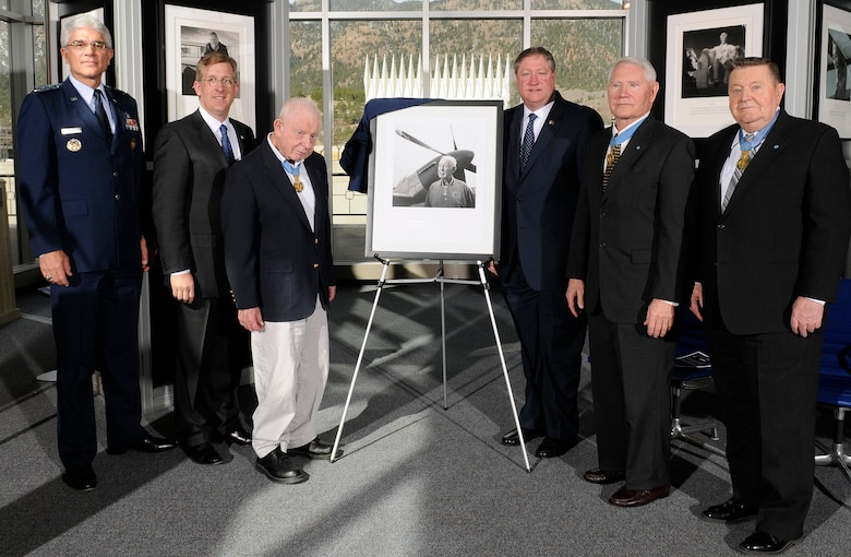 Secretary of the Air Force Michael Donley and retired Col. Bernard Fisher unveil a portrait of Colonel Fisher during the Visions of Valor dedication at the U.S. Air Force Academy in Colorado Springs, Colo., April 3. Pictured here (left to right) are Lt. Gen. John F. Regni, Academy superintendent; David McIntyre, CEO of TriWest Healthcare Alliance, Colonel Fisher, Secretary Donley and retired Cols. Leo Thorsness and Joe Jackson. Colonels Fisher, Thorsness and Jackson are all Congressional Medal of Honor recipients: Colonel Fisher is the first living Airman to receive the Medal of Honor, which he received for heroism during the Vietnam War. (U.S. Air Force photo/Mike Kaplan)