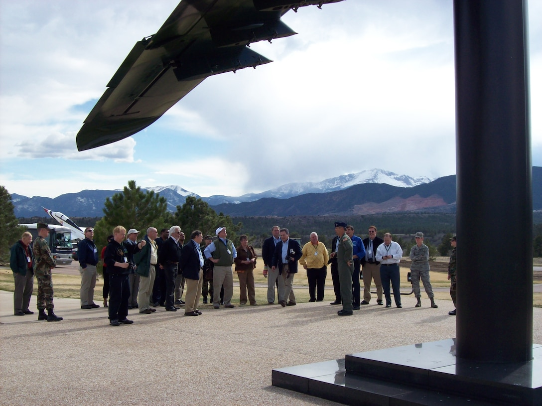 "Col. Robert Swain Jr., 439th Airlift Wing commander, explains to civic leaders how he shot down an Iraqi helciopter with the A-10 Thunderbolt II he flew during the first Golf War. The aircraft pictured is on display at the Air Force Academy, and nickamed the ""chopper popper."" Twenty-three leaders from western Massachusetts toured the academy and Peterson Air Force Base, Colo. (US Air Force photo/Senior Master Sgt. Sandi Michon)"