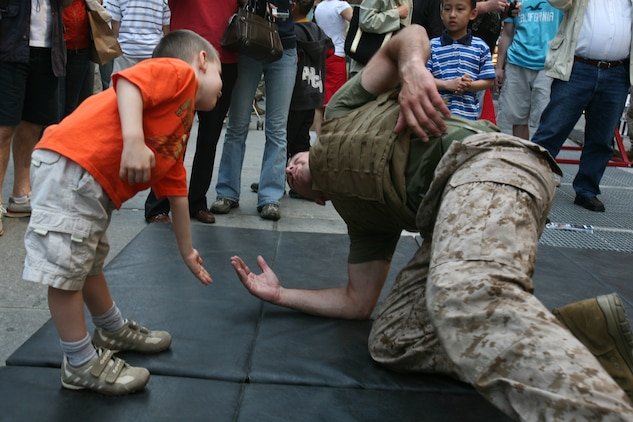 Marines from Special Purpose Marine Air Ground Task Force New York demonstrate the Marine Corp Martial Arts Program (MCMAP) as part of Marine Day in Times Square. The Marines developed a martial arts discipline by mixing together most of today's popular fighting techniques. (Official Marine Corps photo by Sgt. Steve Cushman)