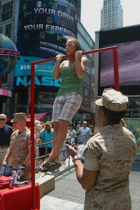 Kyla Kennedy of Plattsburgh N.Y. tries a flexed arm hang during Marine Day celebrations in Times Square May 23. (Official Marine Corps photo by Lance Cpl. Jad Sleiman)