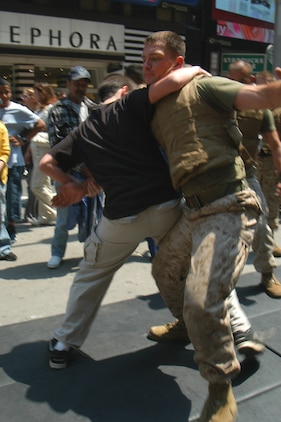 Nick  of Waterbury, Conn., takes down a Marine from Special Purpose MAGTAF New York using a leg sweek during Marine Day celebrations in Times Square May 23. (Official Marine Corps photo by Lance Cpl. Jad Sleiman)