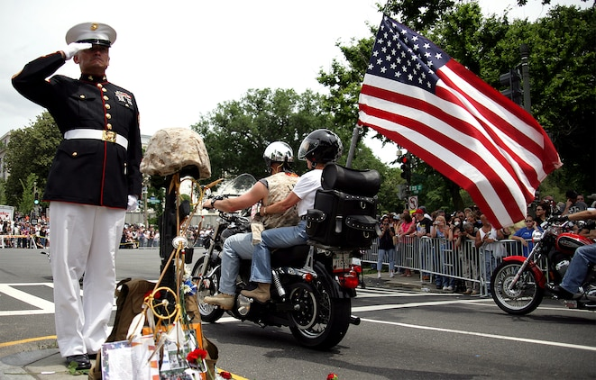 Staff Sgt. Tim Chambers stands as he's done for the past seven years to honor the fallen American service members during the 22nd annual Rolling Thunder May 24. This Memorial Day weekend he stood for three hours.