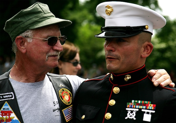 A Marine Vietnam veteran embraces Staff Sgt. Tim Chambers to thank him for his support of all veterans. This Memorial Day weekend, Chambers stood as the embodiment of America's generations of service members and rendered a three hour salute as he's done for the past seven years to every service member passing by.